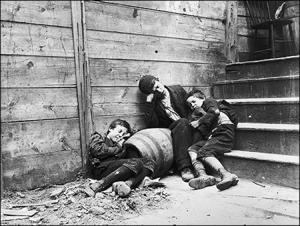 "Image: Photo of street children in ""sleeping quarters"" taken by Jacob Riis in 1890. From the Library of Congress."