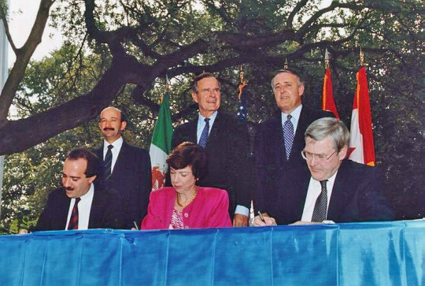 Image: Photograph taken at the NAFTA initialing ceremony in 1992. From the Wikimedia Commons.
