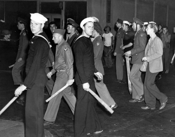Image: Photo of sailors, soldiers, and marines with wooden clubs during the Zoot Suit Riots in 1943. From the Library of Congress.