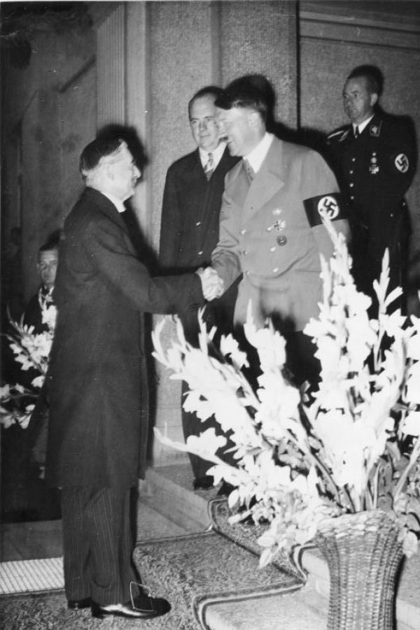 Image: Photo of Neville Chamberlain and Adolf Hitler at the Munich Agreement in 1938. From the Wikimedia Commons.