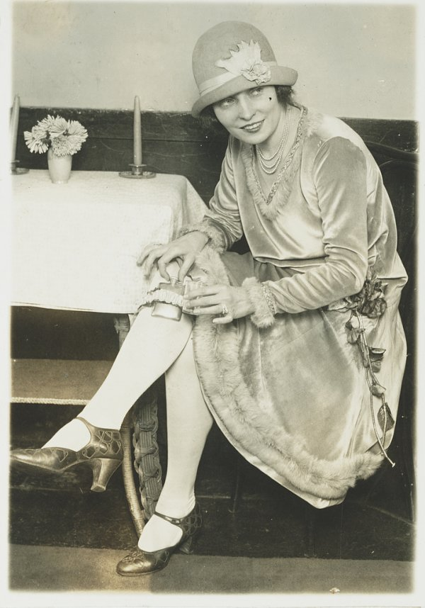 Image: 1926 photo of a woman showing the garter flask fad during Prohibition. From the Library of Congress.