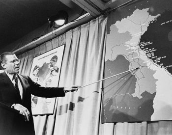 Image: Photo of Secretary of Defense McNamara at a press conference taken by Marion S. Trikosko, 1965. From the Library of Congress.