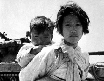 Image: Photo of a Girl and her brother during the Korean War by Maj. R.V. Spencer, 1951. From the Flickr Commons.