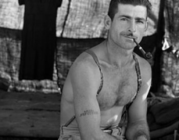 Image: Photo of unemployed lumber worker with social security number tattooed on his arm taken by Dorothea Lange in 1939. From the Library of Congress.