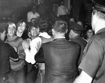 Image: Police push protestors back outside of the Stonewall Inn in the early hours of June 28, 1969. From the Wikimedia Commons.