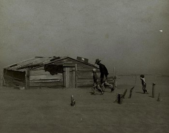 Image: Photo of Oklahoma farmer and sons walking in the face of a dust storm taken in 1936 by Arthur Rothstein. From the Library of Congress.
