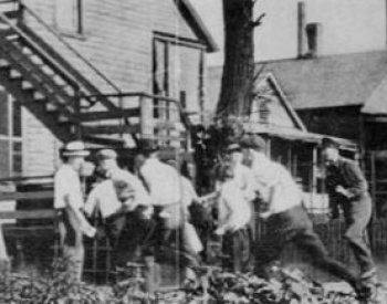 Image: Photo of a white gang looking for blacks during the Chicago race riots of 1919. From the Wikimedia Commons.