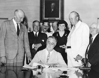 Image: Photo of President Roosevelt Signing the 1935 Social Security Act. From the Wikimedia Commons.