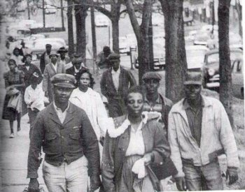 Image: Photo of Black residents walking during the Montgomery Bus Boycott in 1955. From BlackPast.org.