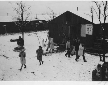 Image: Photo of people leaving Buddhist church in Manzanar Relocation Center taken by Ansel Adams in 1943. From the Library of Congress.