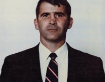Image: Police photograph of Oliver North in 1988. From the Wikimedia Commons.